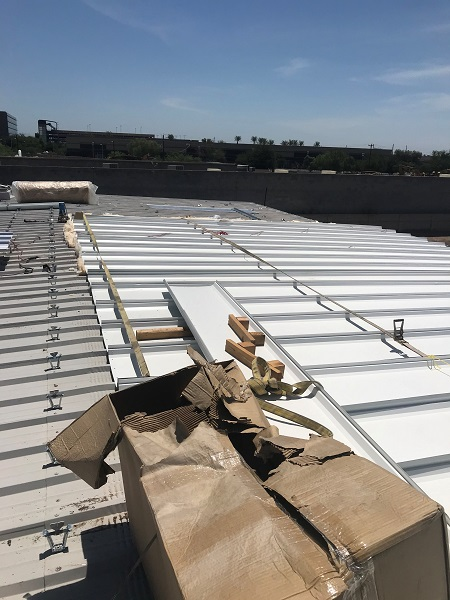 New low profile metal over metal roofing installed on right